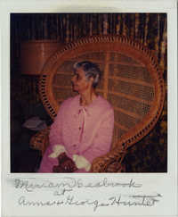 Miriam DeCosta Seabrook sitting in wicker chair