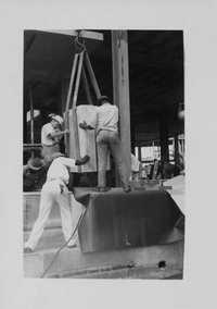 Gently moving the Naval Hospital Cornerstone in place