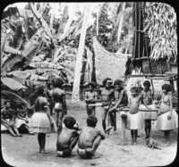 In a Papuan Village, New Guinea.