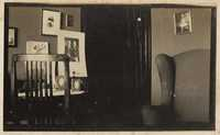 Room interior with family photographs on walls, probably the home of Christopher and Pauline Donner in Philadelphia