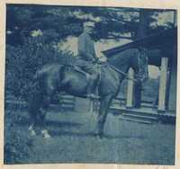 Man astride horse