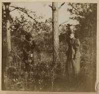 Pauline Donner and unidentified in wooded area