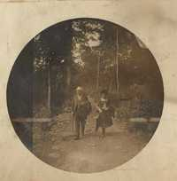 Couple walking along a wooded path.