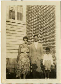 Miriam DeCosta Seabrook, Raymond T. DeCosta, and Hebert U. Seabrook, Jr. standing outside.