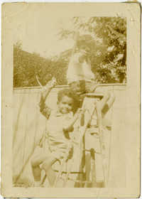 Herbert U. Seabrook, Jr. and Charles DeCosta sitting on a ladder