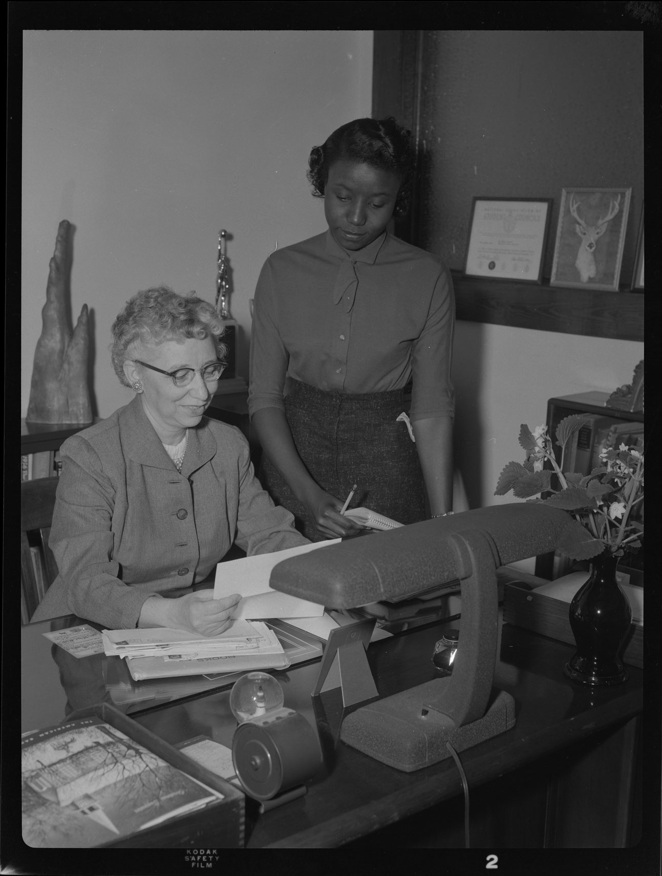 Miss Anderson and young woman in Anderson's office