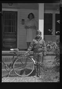 Cub scout with bicycle