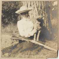 Pauline Donner and dog on Halls Island, gun across her lap