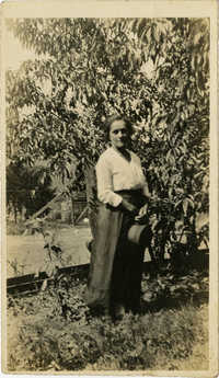 Woman standing in front of tree