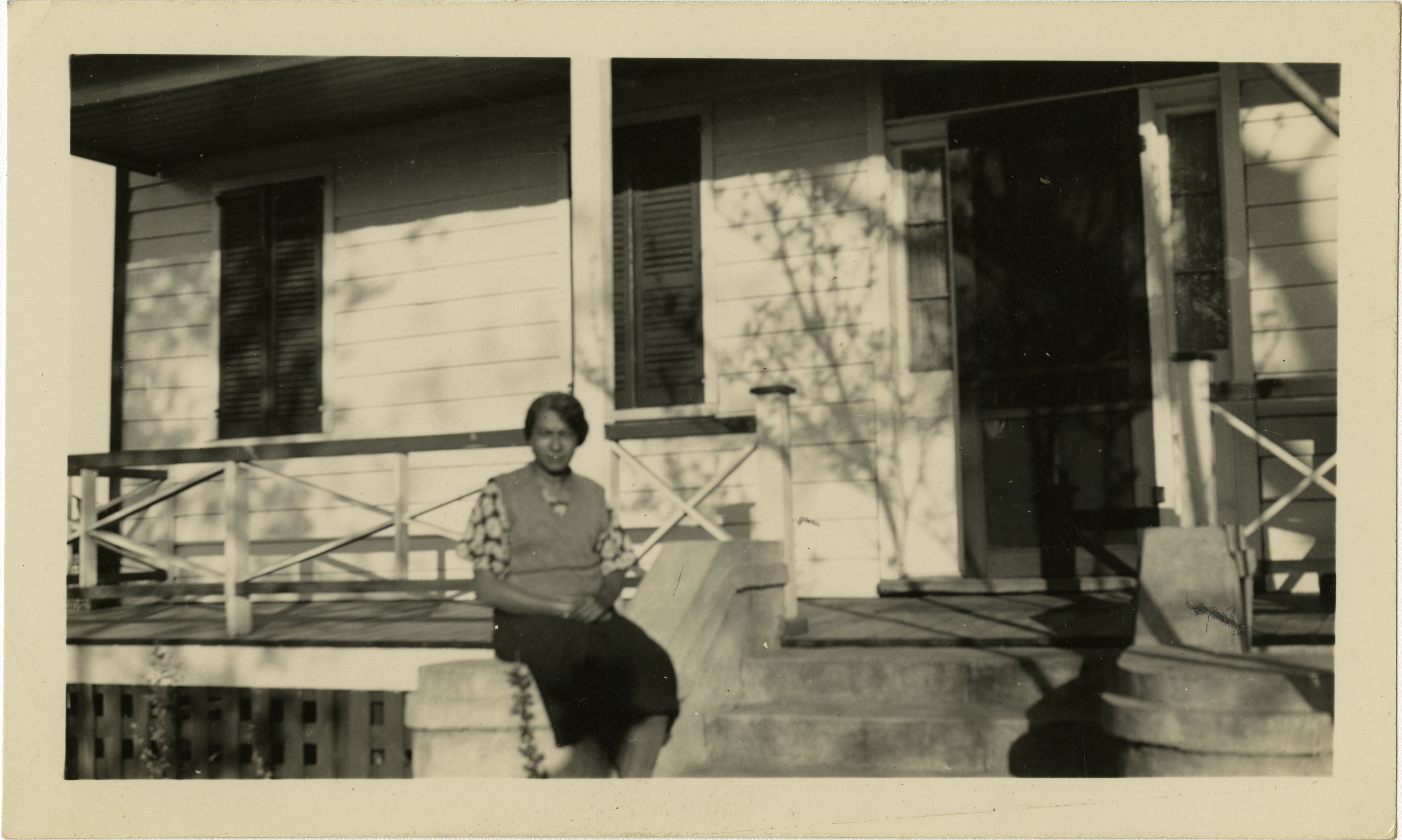 Woman sitting on porch