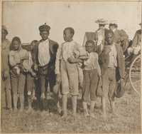 Group of children in front of wagon