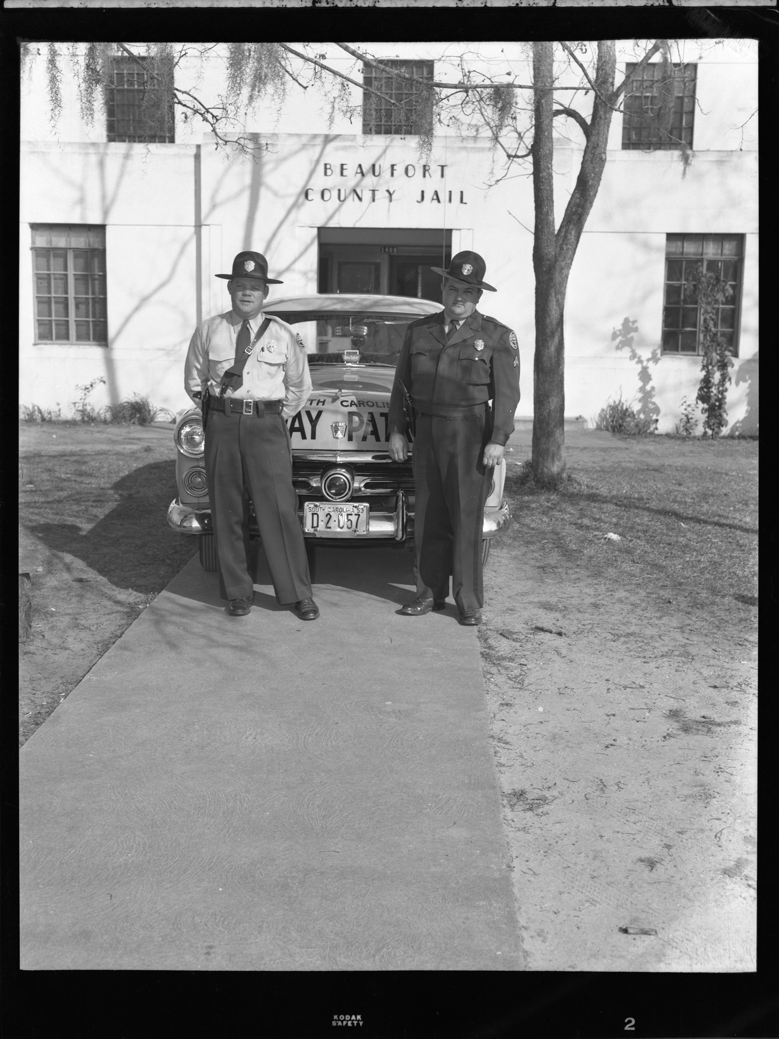 Highway Patrolmen and Car in front of Beaufort County Jail