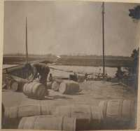 Barrels ready to be loaded on boats