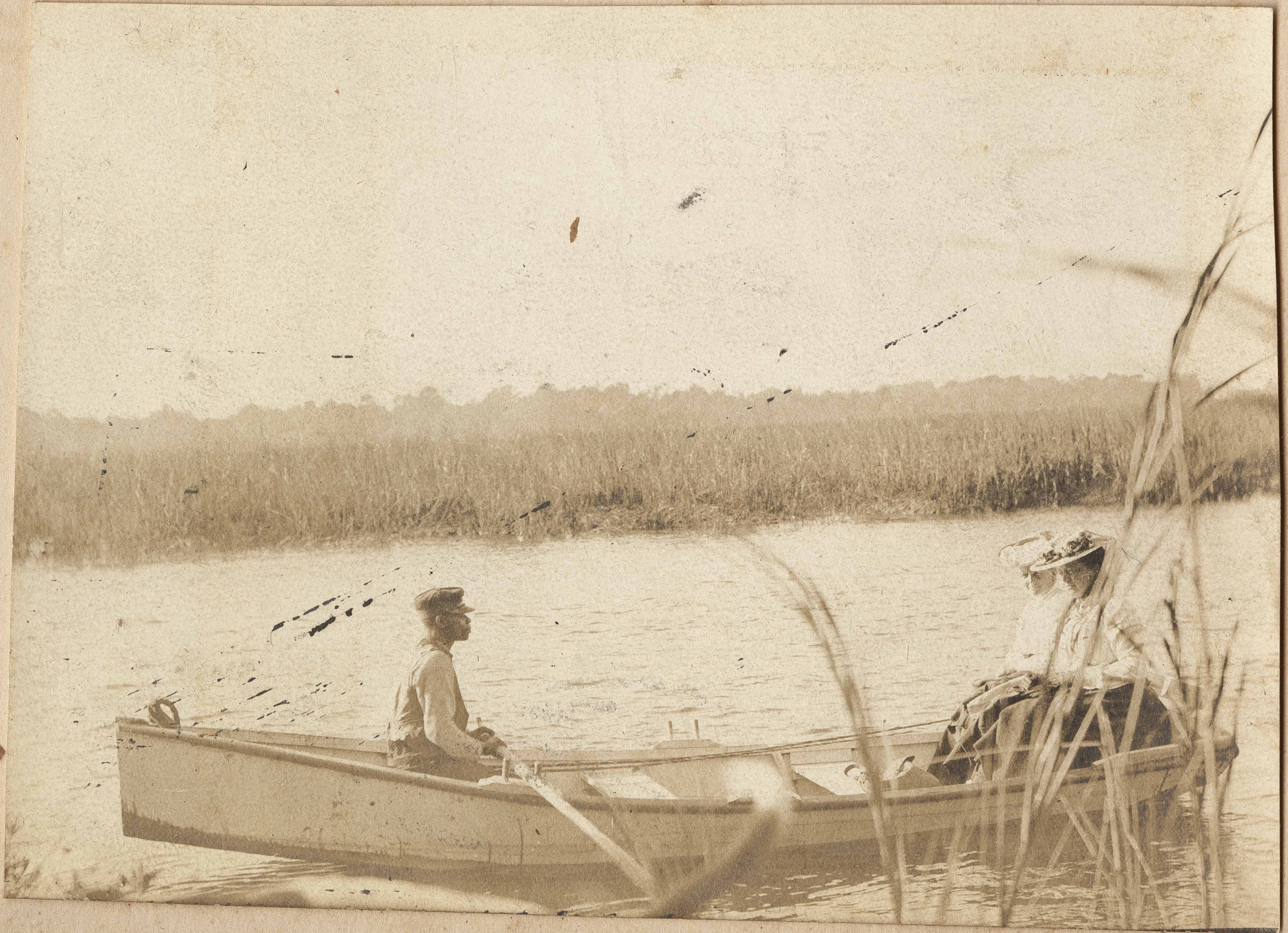 Man rowing woman in boat on the river