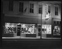 Martin's Mens Store and Palmetto Studio display windows along Bay Street