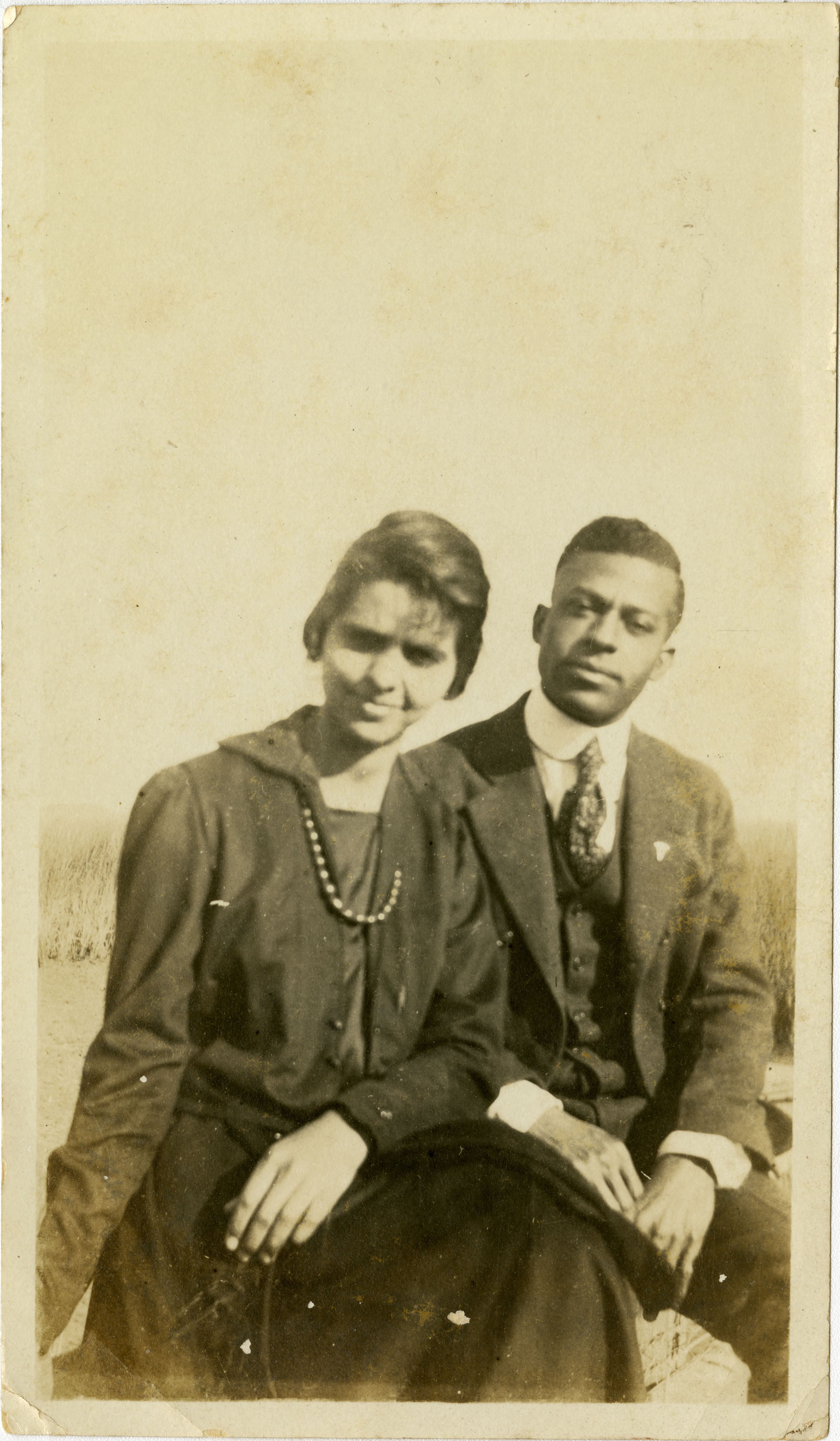 Miriam DeCosta Seabrook and Herbert U. Seabrook, Sr. sitting outside