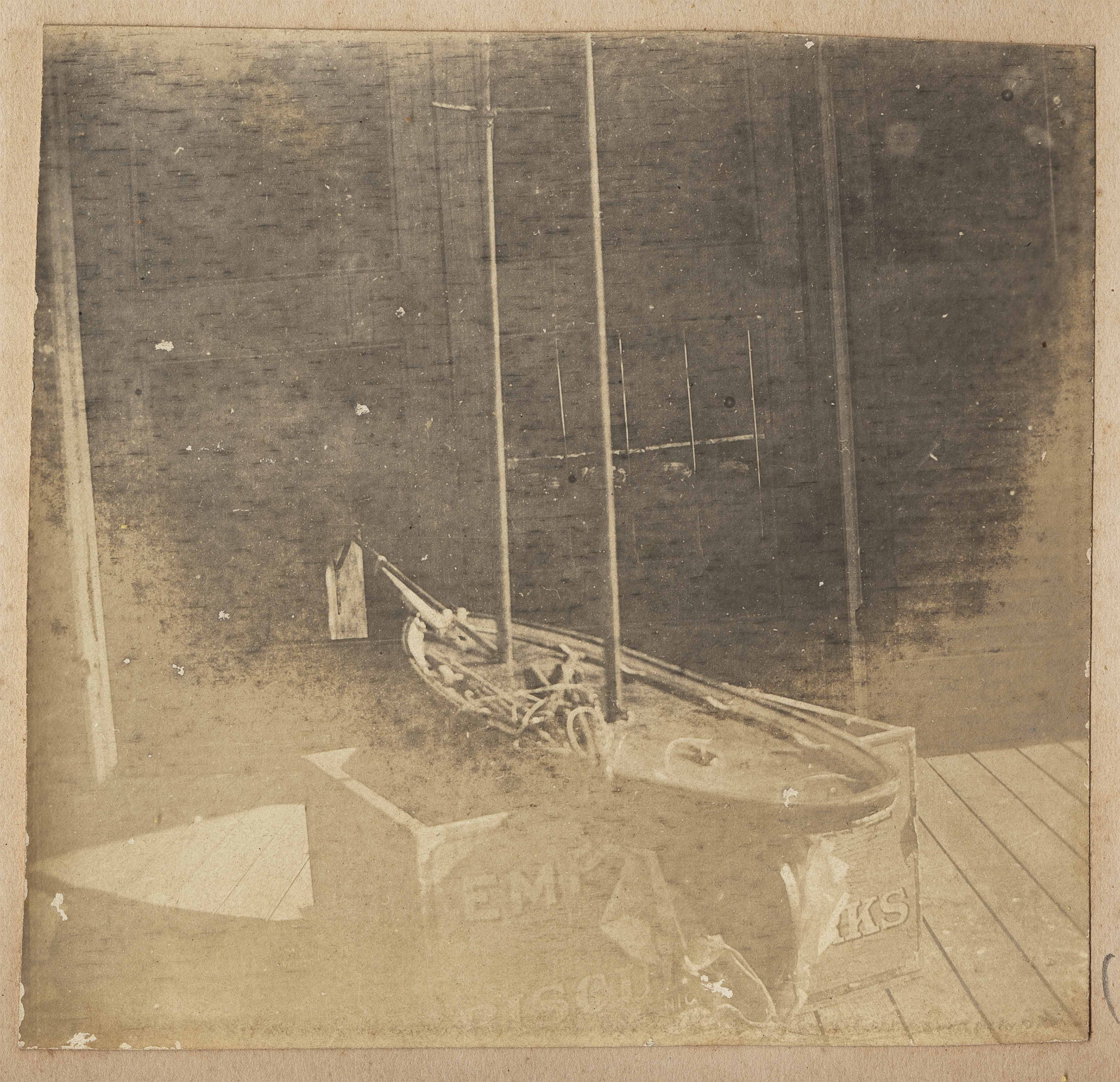 Two-masted model boat on dock