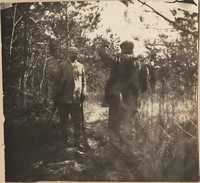 Two men hunting in the woods