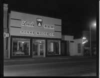 Horne Motor Co. at night