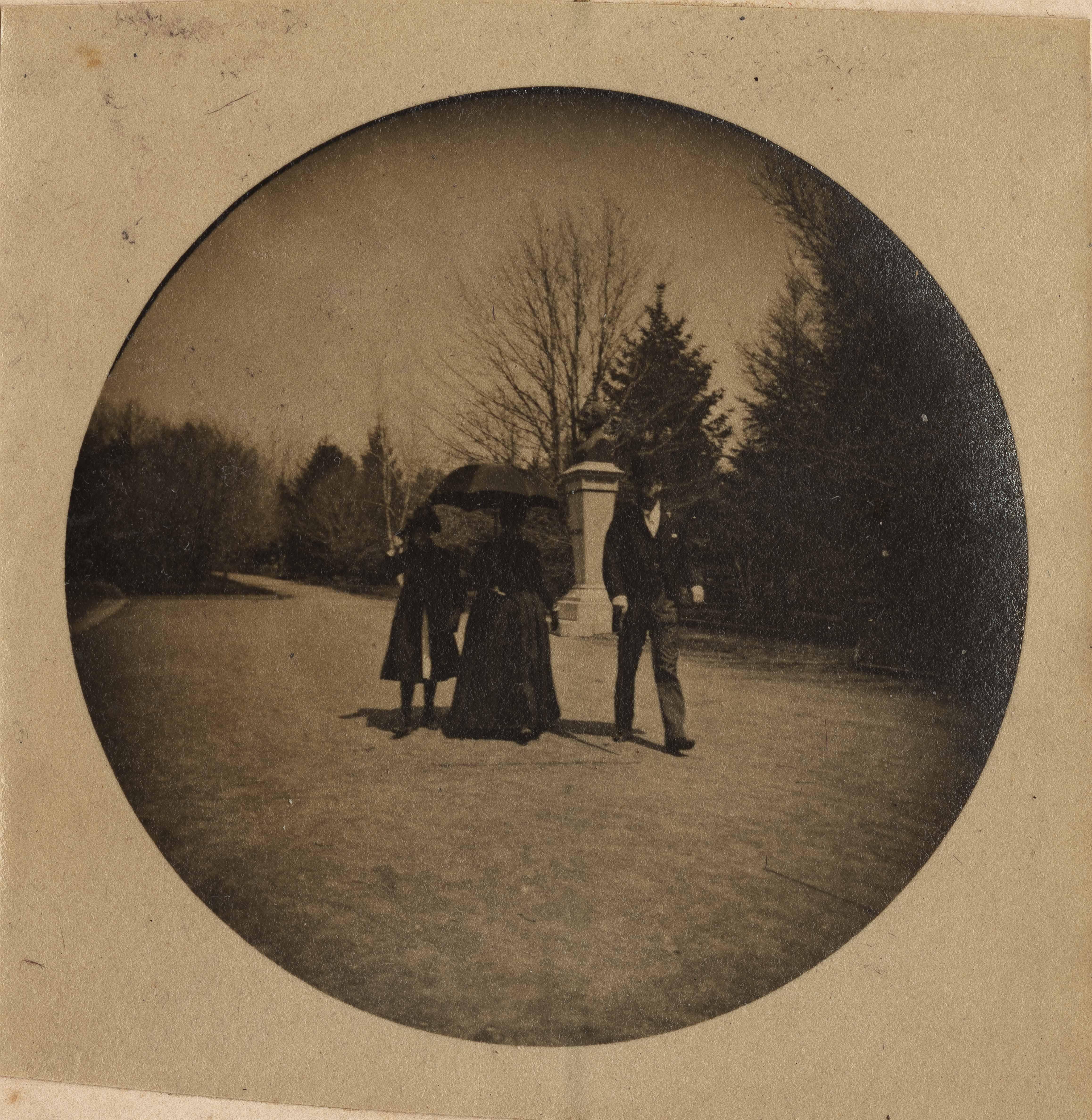 Three people on a walk.