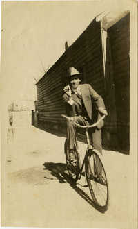 Man posing on bicycle