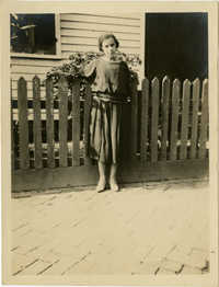 Woman standing in front of fence