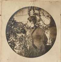 Unidentified woman in garden.  Side view.