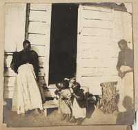 Women and children near cabin step