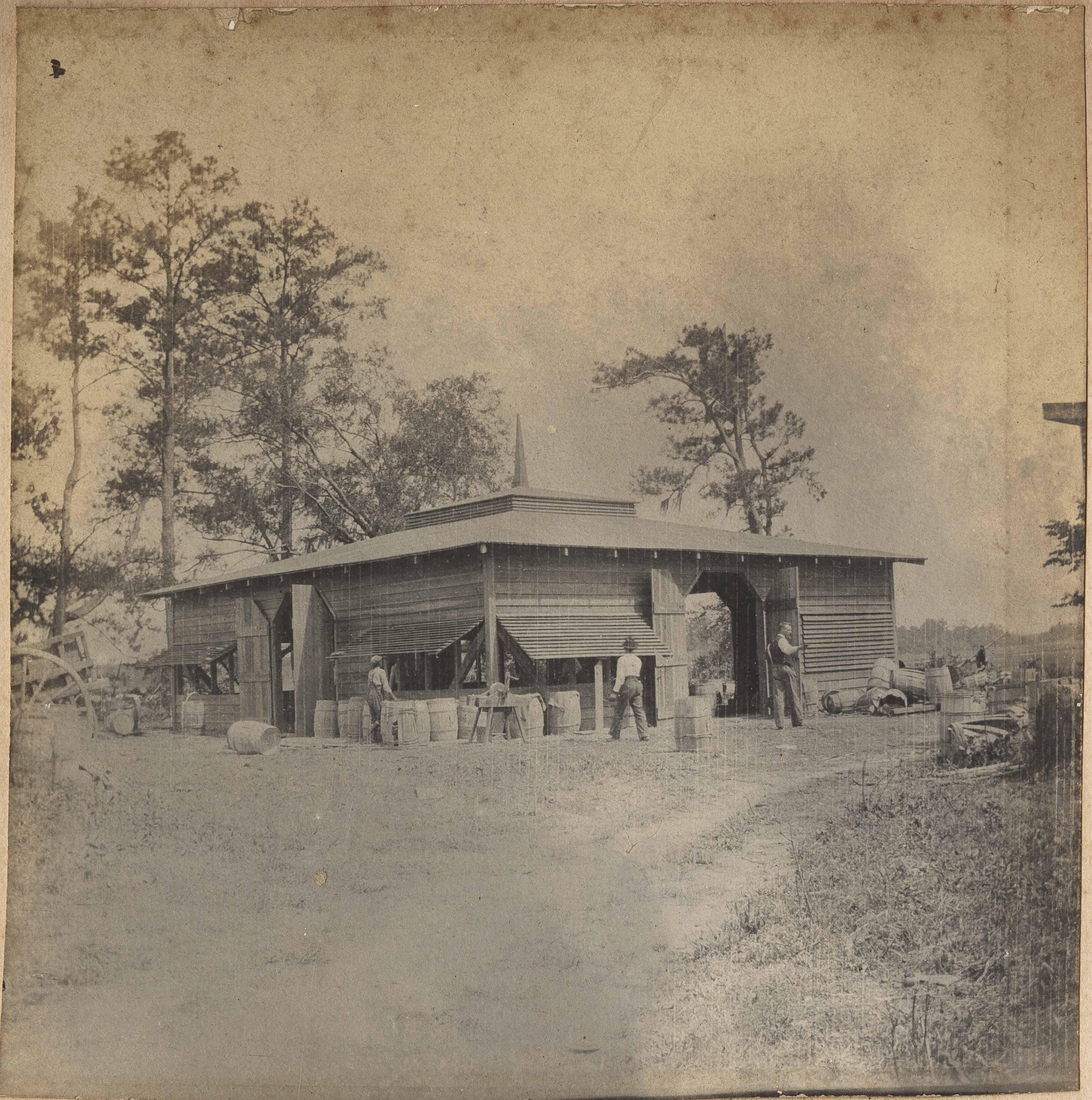 Barrels beside Packing shed at Halls Island