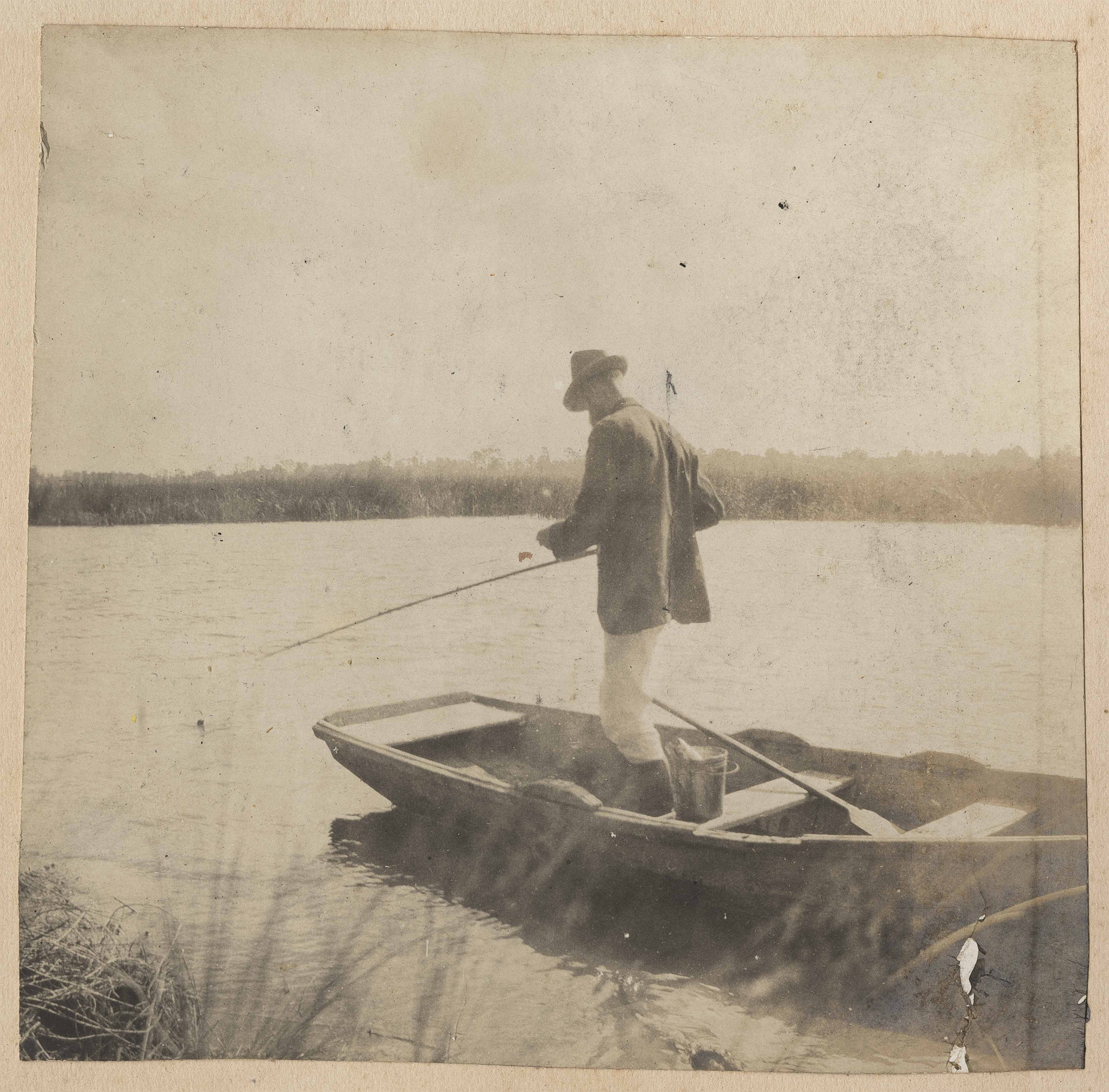 Man fishing from boat