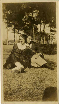 Elizabeth DeCosta Sartor and unidentified woman sitting outside