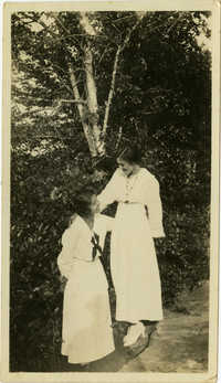 Miriam DeCosta Seabrook and unidentified woman standing outside