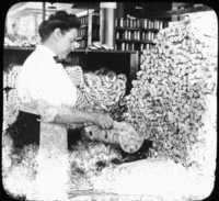 Weighing and Sorting Raw Silk Skeins, So. Manchester, Conn.