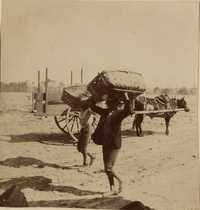 Two men with bushel baskets and wagon