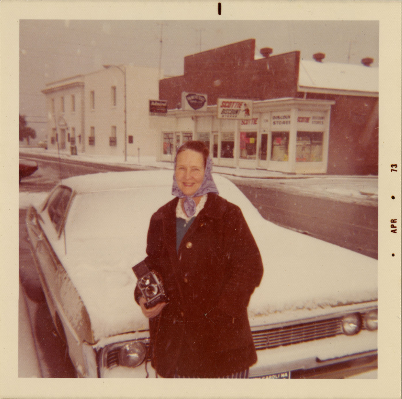 Lucille Culp with her camera on Bay Street after the snowfall