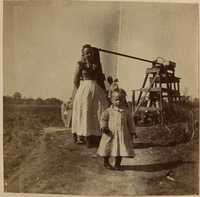 Woman and child near well