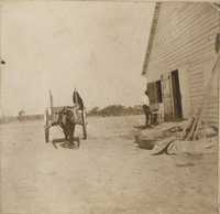 Wagon near outbuilding