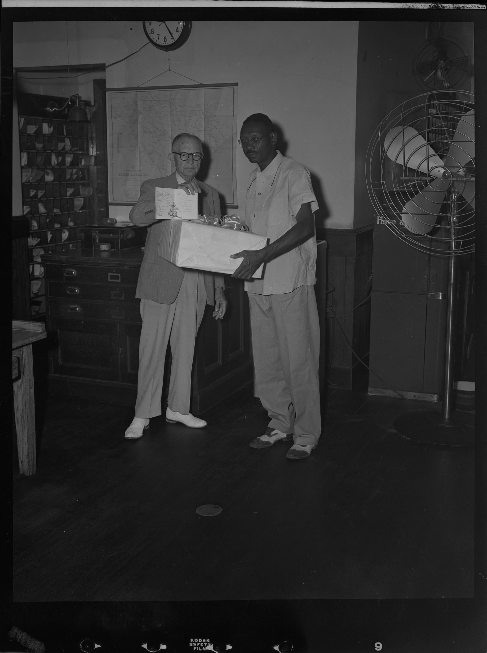 Mr. Hall presenting package to Negroe [sic] at Post Office