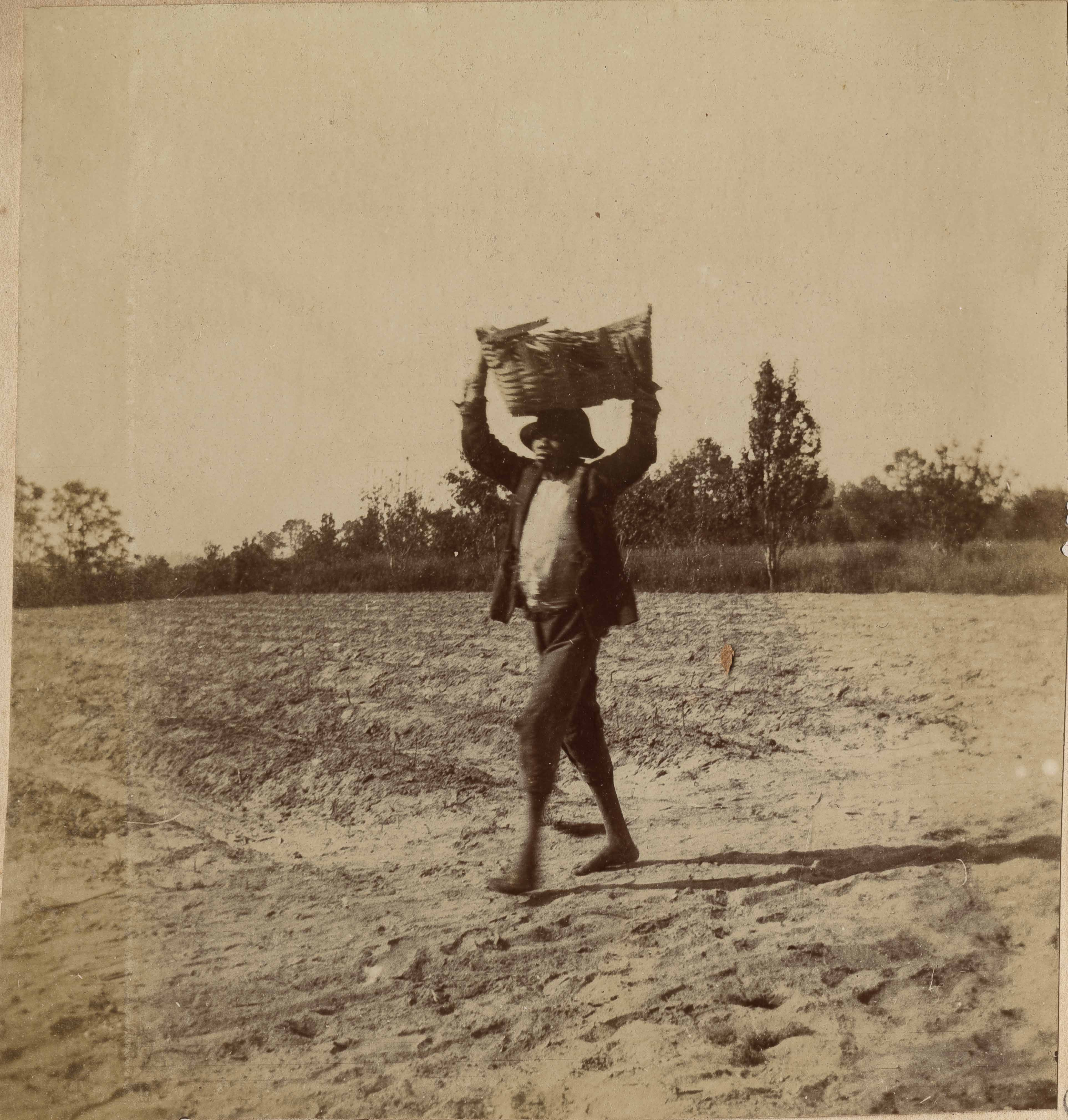 Man walking with basket on his head