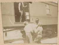 Loading packing crates onto railroad car