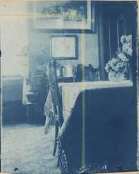 Room interior.  Dining table with vase of flowers.