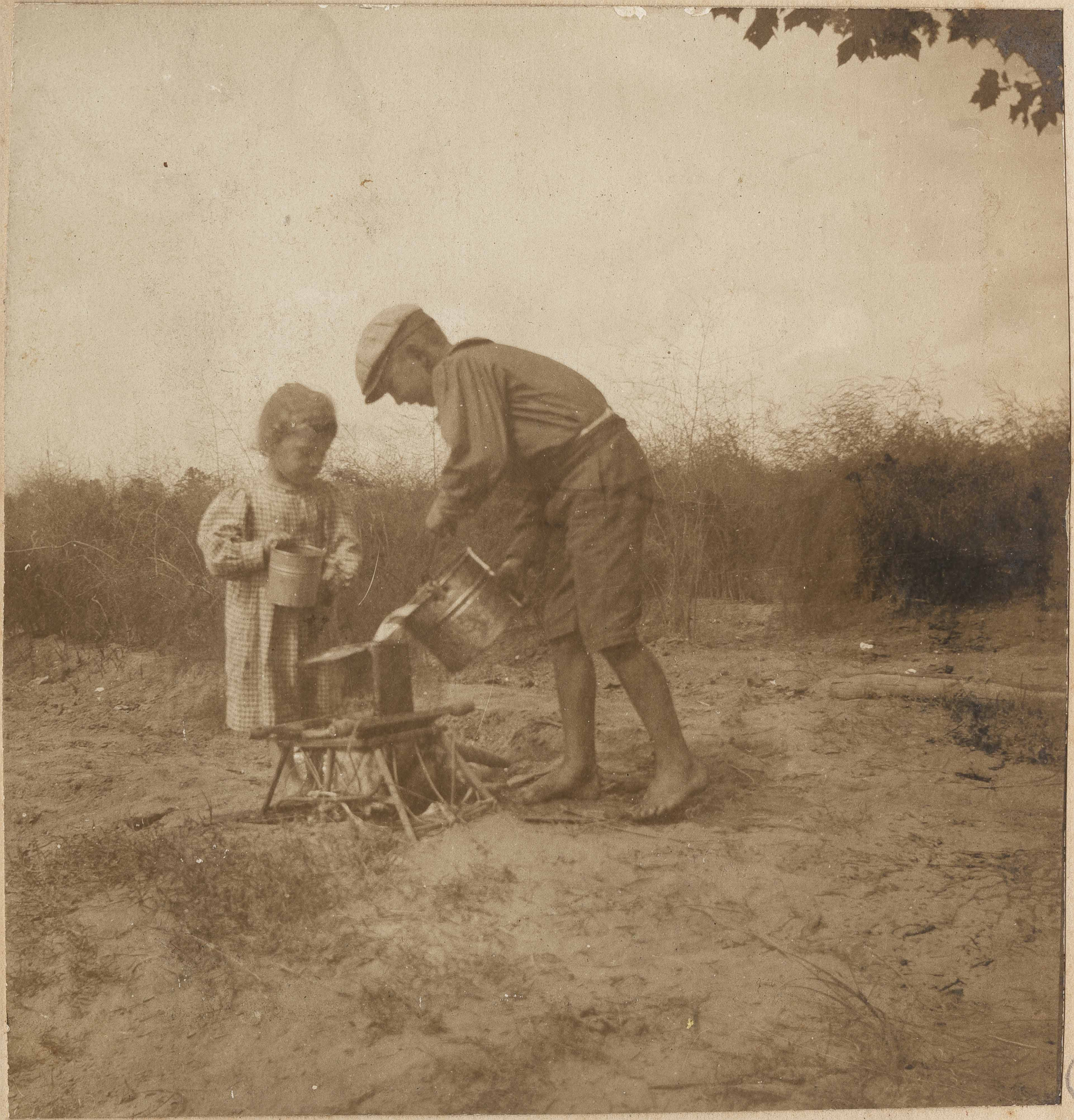 Two children with buckets