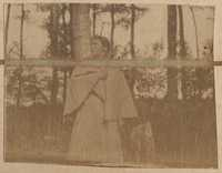 Unidentified woman from group in 40ae and 40af stands alone