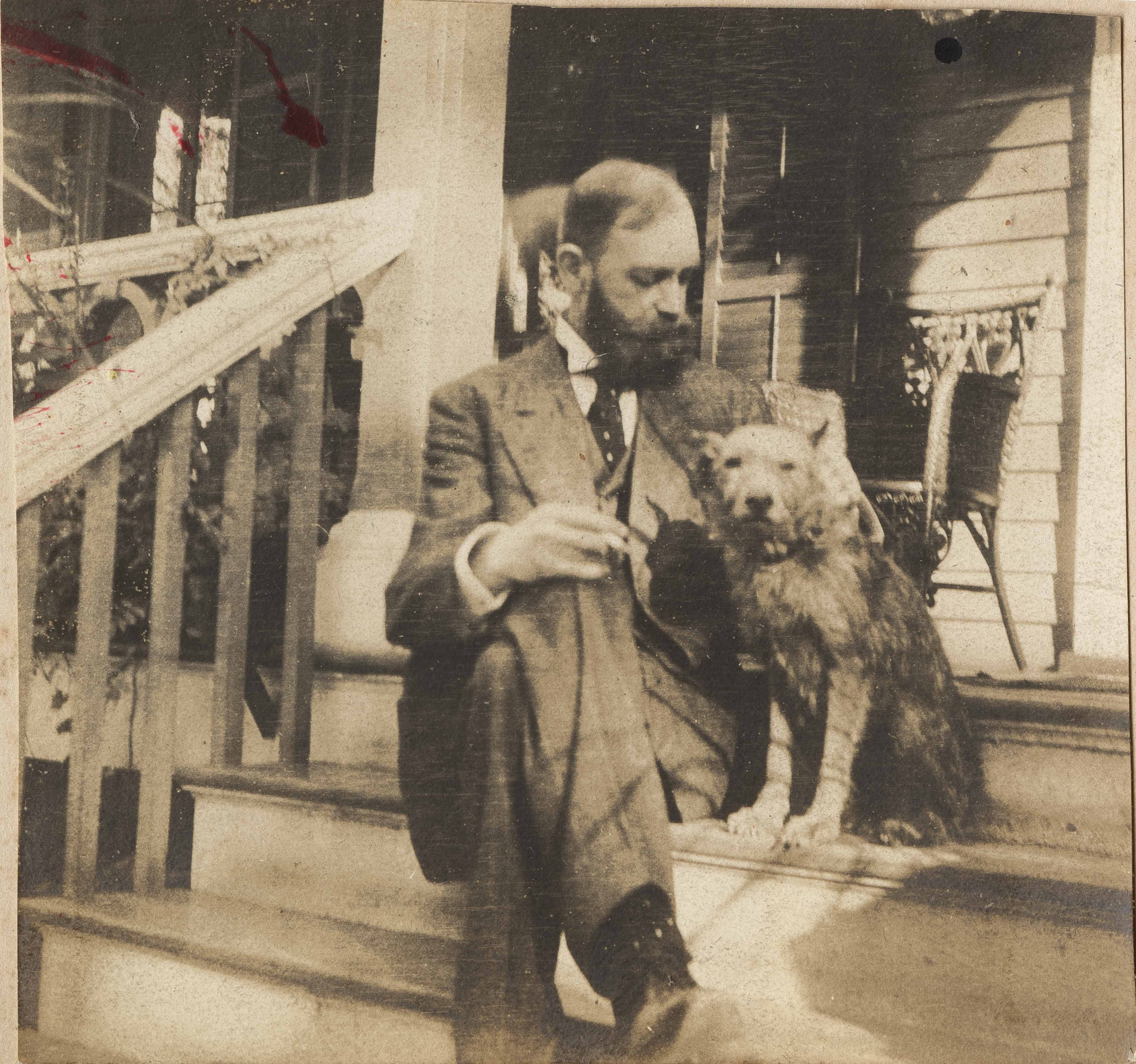 Christopher Donner with dog on steps to unidentified house