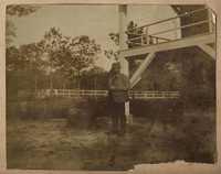 Unidentified man outside Main house