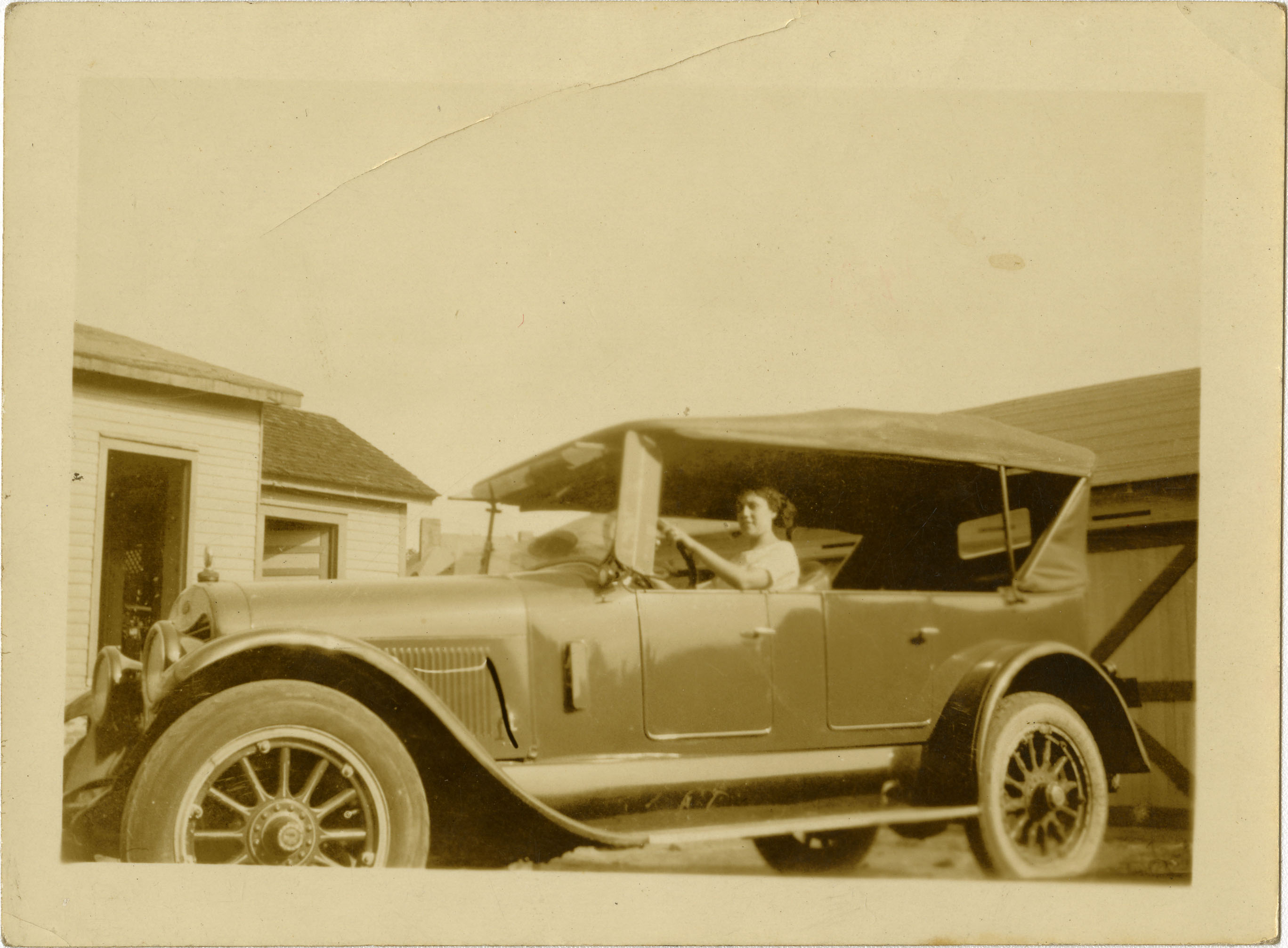 Woman sitting in automobile