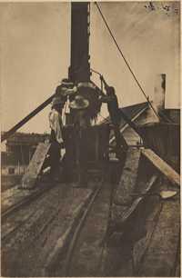Men repairing equipment at the Mill.