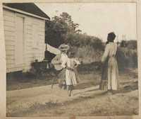 Girl dances while Pauline Donner plays a guitar