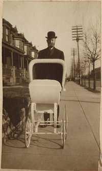 Christopher Donner pushing baby pram in West Philadelphia
